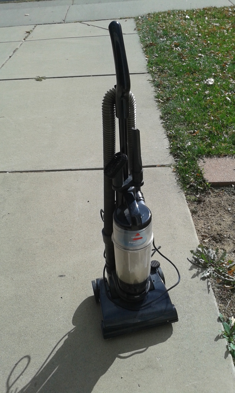 vacuum cleaner on the sidewalk