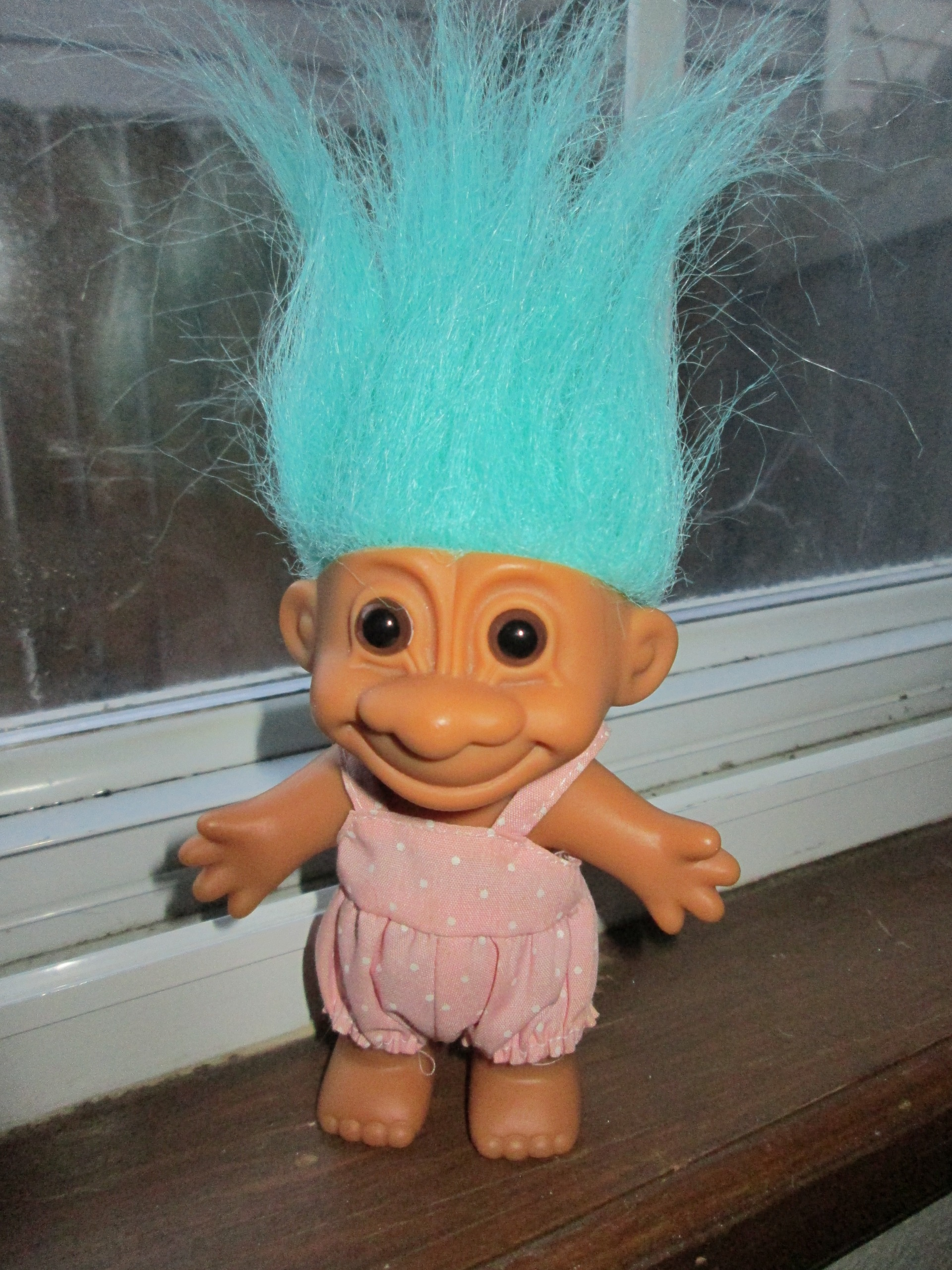 tiny troll doll with neon turquoise hair