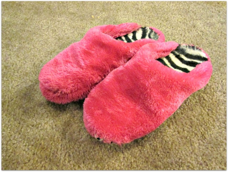 pair of pink fuzzy slippers