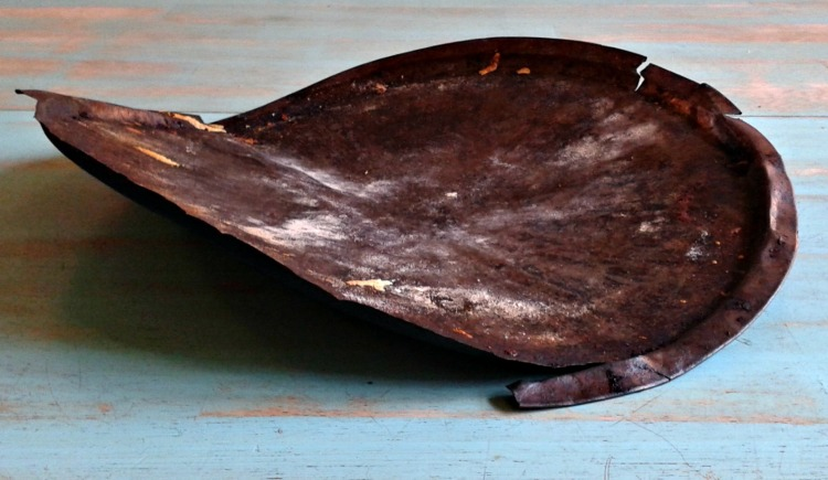 buckled rusty pizza pan