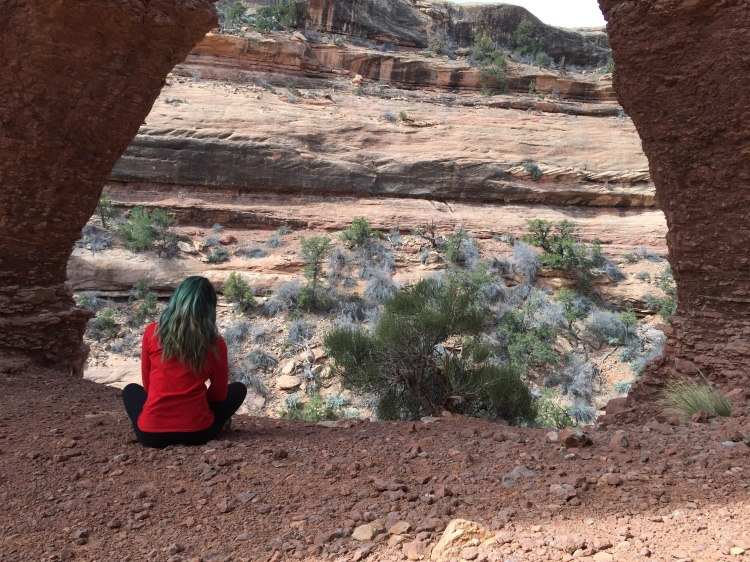 girl looking out over a canyon in Utah